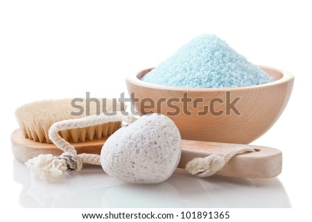Spa arrangement with sea salt and bathing brush on white background