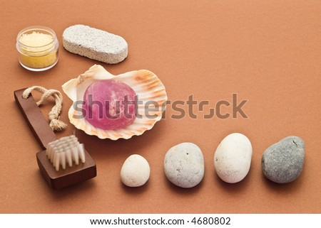Spa arrangement with stones, brush, soap and marine salt