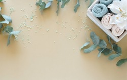 Spa  background. bath  products  towels, aroma salt, body scrub. eucalyptus leaves  on beige backdrop. Beauty, wellness, body care concept. top view. copy space