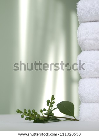 Spa background: pile of white towels. - stock photo