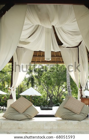 spa bale with cushions and curtains in tropical Bali