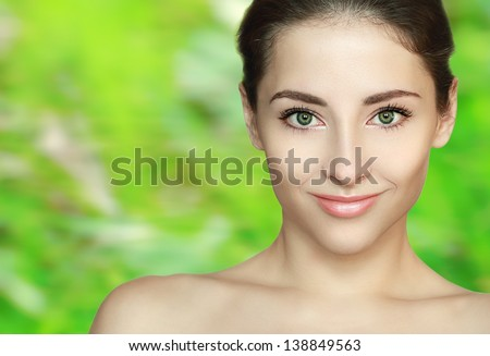 Spa beauty girl face with clean skin on green bright background