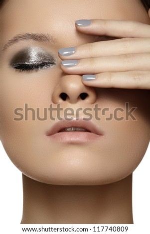 Spa, beauty, skincare, wellness & health. Glamour close-up portrait of beautiful woman model face with purity healthy skin & silver make-up and grey manicure. Cold winter christmas makeup