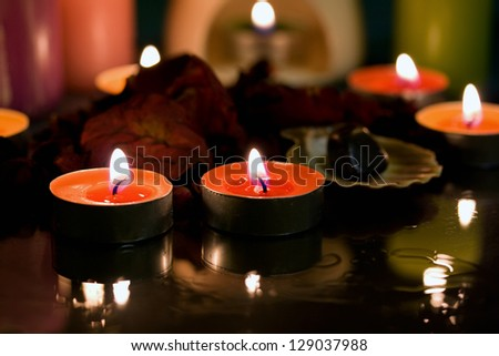Spa candle with rose petals in water