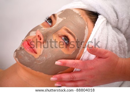 Spa clay mask on a woman\'s face, white background