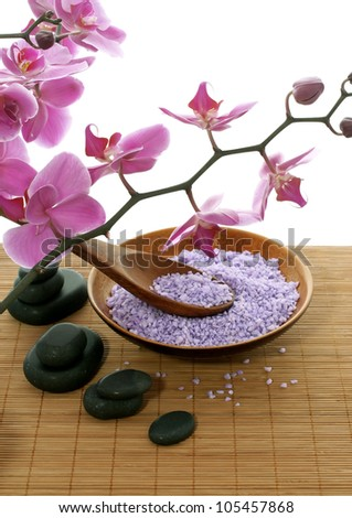 spa composition of bath salt, stones and orchid flowers