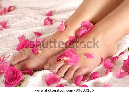 Spa composition of legs and flowers
