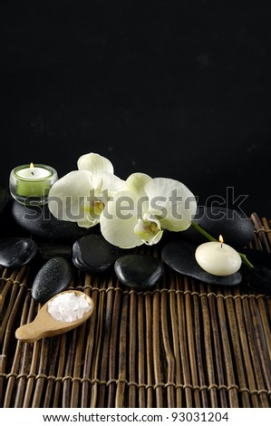 spa composition of orchid, stones and candle,