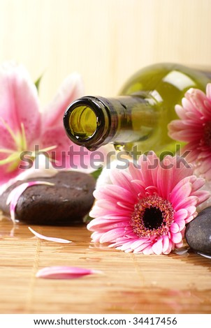 Spa composition (Warning! Only the bottle neck and a part of the flower are in focus)