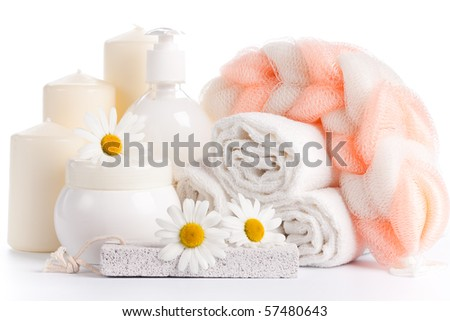 Spa composition with camomile on a white background.