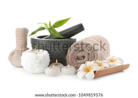 Spa composition with mortar, candles and clean towel on white background #1049819576