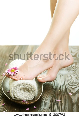 Spa concept.Beautiful Woman Legs with flower