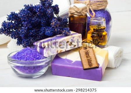 Spa concept. Lavender handmade soap and accessories for body care (lavender, soap, towel, sponge, sea salt)