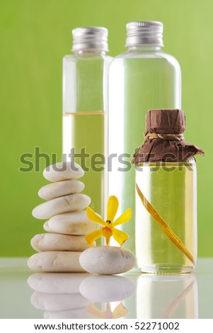 spa concept with balance stone,oil bottles and yellow orchid