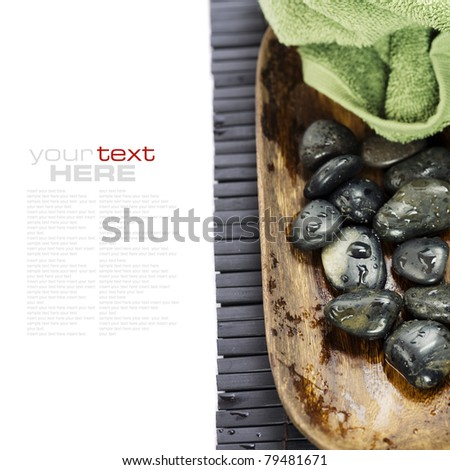 spa concept (zen stones and towel) over white with sample text - stock photo