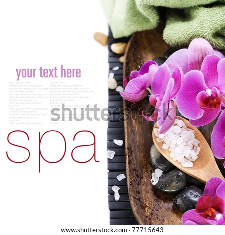 spa concept (zen stones, sea salt, towel and orchid) over white with sample text