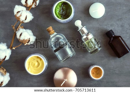 SPA cosmetic products on dark table from above. Coconut, argan oils, organic creams and serums. Beauty blog flatlay #705713611