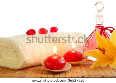 Spa Decoration With Candles And Red Bottle With Massage Oil Stock ...