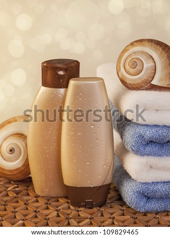 Spa elements with towels,candle and bottles