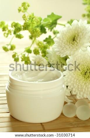 Spa essentials. Cream and flowers.