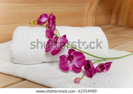 Spa essentials (white towel and pink orchids)