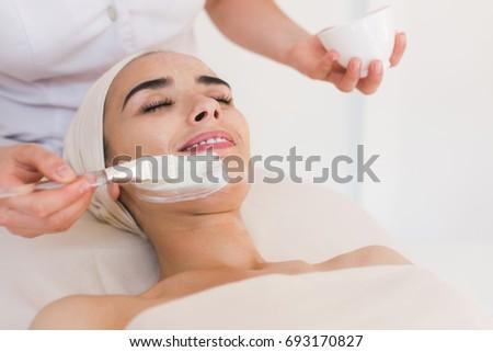 Spa facial mask application. Spa beauty organic facial mask application at day spa salon. Beauty treatment in spa salon. #693170827