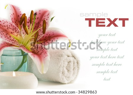 Spa feeling (flower, towel and candles reflected in water). With sample text