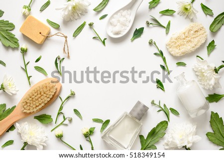 Spa floral background, flat lay of various beauty care products decorated with simple white flowers, blank space for your text