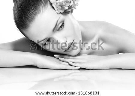 Spa. Fresh clear healthy skin on the face of beautiful woman . Black and white
