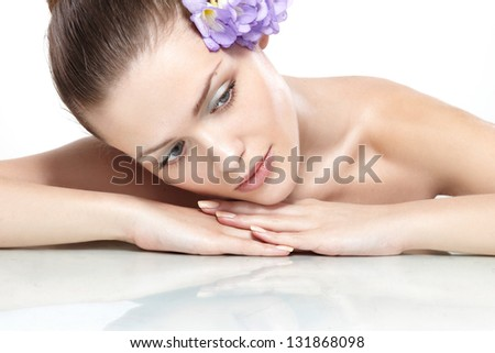 Spa. Fresh clear healthy skin on the face of beautiful woman over white background