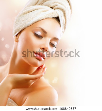 Spa Girl. Beautiful Young Woman After Bath Touching Her Face. Perfect Skin. Skincare. Young Skin