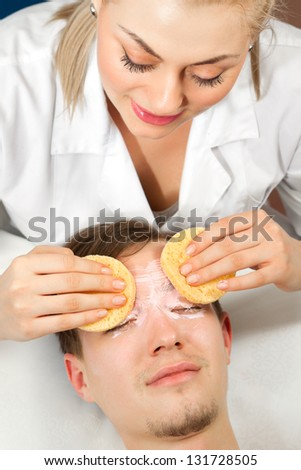 Spa. Handsome Man with a facial Mask on his Face