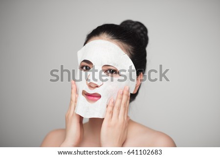 Spa, healthcare. Asian girl with a cosmetic mask. #641102683