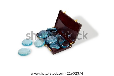 Spa home treatment consisting of decorative smooth stones in a burgundy leather Briefcase used to carry items to the office