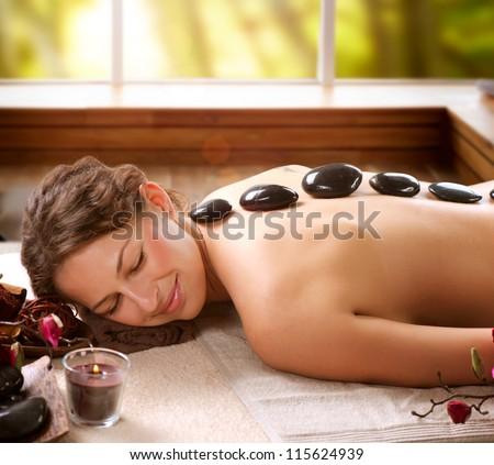 Spa Hot Stone Massage - stock photo