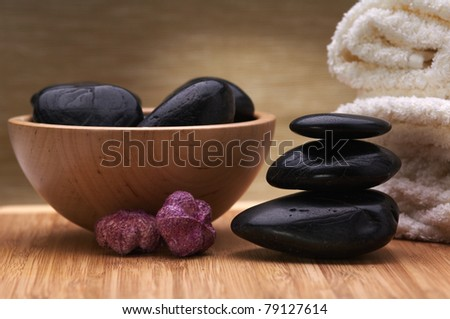 spa hot stone massage concept, towel, stones and potpourri