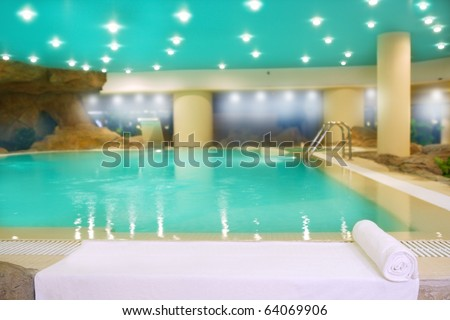 spa indoor turquoise saloon water white towel lights ceiling