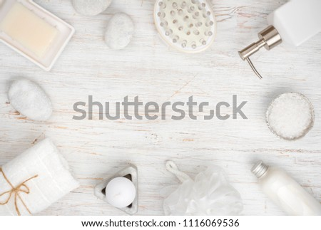 Spa items and cosmetics on wood, copy space in center #1116069536