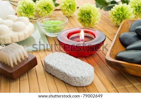 spa items with candle soap brush stone