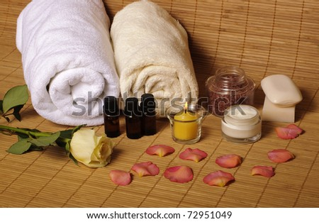 Spa items with rose and petals - stock photo