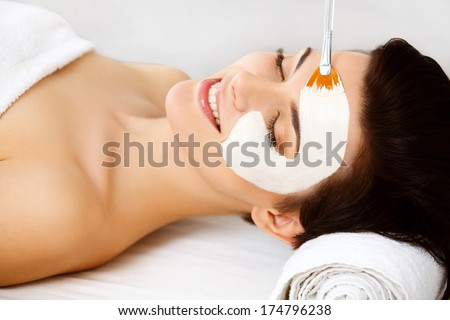 Spa Mask. Woman in Spa Salon. Face Mask. Facial Clay Mask. Treatment