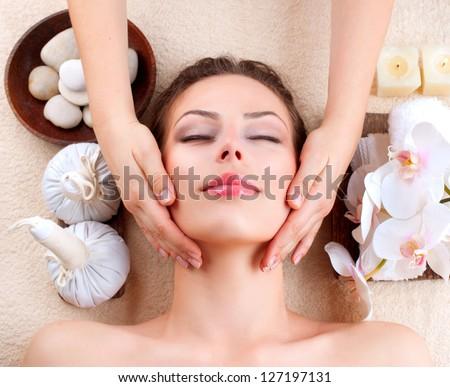 Spa Massage . Beauty Girl Getting Facial Massage