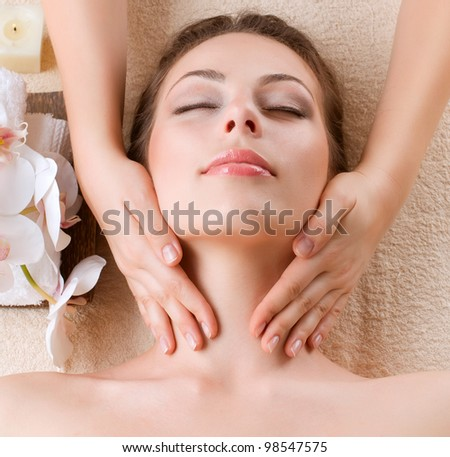 Spa Massage . Beauty Girl Getting Facial Massage