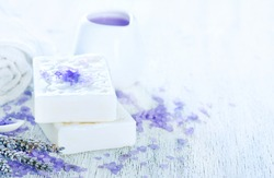spa objects, lavender soap and towel on a table