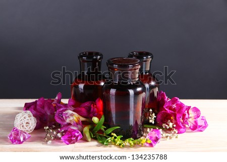 Spa oil and freesia on gray background