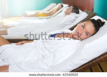 spa relax room hammock row beautiful girl and men in background - stock photo