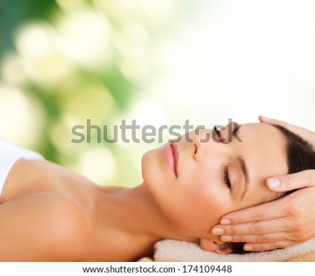 spa resort beauty and health concept beautiful woman in spa salon getting face treatment