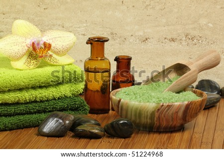 Spa resort composition - bath soap, towels, orchid flower, bottles with lotions