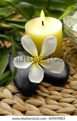 Spa resort composition - candles, orchid flowers, zen stones
