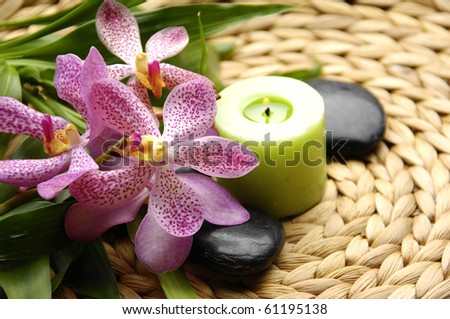 Spa resort composition - candles, orchid flowers, zen stones